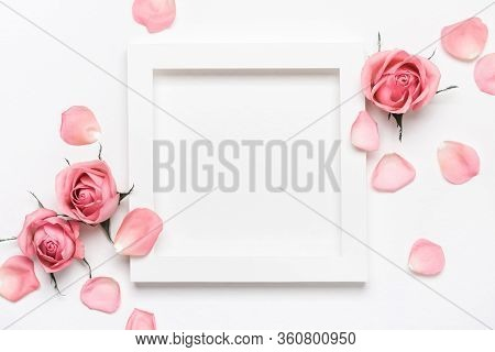 Square White Frame And Pink Roses On White Background. Beautiful Flower Arrangement For Your Design