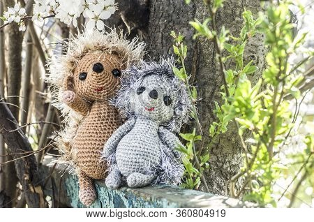 Crochet Toy Hedgehog On Natural Background. Cute Handmade Souvenir.