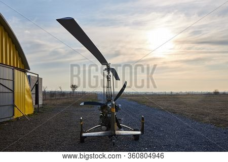 Single Place Ultralight Homemade Gyroplane Stands At The Airport Near The Hangar In The Early Mornin