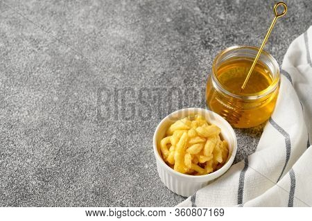 National Food Cuisine Of The Middle East. White Ramekin With Chak Chak And Honey In A Jar On A Gray