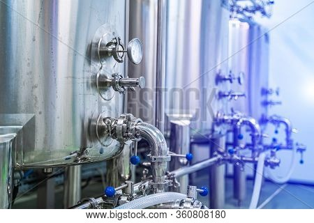 Dairy Production. Apparatus For Bottling Milk Products. Steel Tanks At Milk Factory. Dairy Factory W