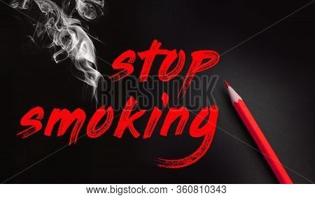 Stop Smoking Words, Red Pencil And Smoke On Black Background. No Smoking Quit Addiction Concept