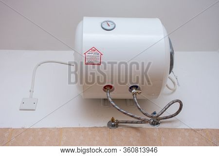 Hanging Hot Water Heater On A White Wall In The Bathroom For Temperature Controlled Shower And Bath