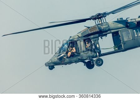 Military Chopper Close Up Shooting In War Flies Through The Sky. Military Concept Of Power, Force, S