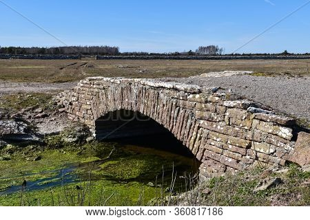 Old Stone Bridge Crossing A Small Creek On The Island Oland In Sweden