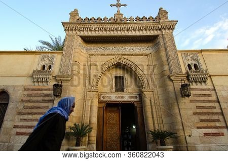 Cairo, Egypt. December 31st 2012  An Old Egyptian Copt Walking Past The Entrance To The Hanging Chur