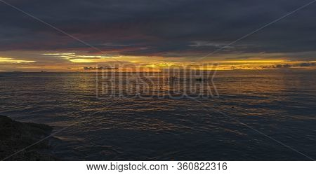 Beautiful Sunset In The Evening And Local Fishermen Fishing From Boats In Indian Ocean Near Padang,