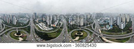 Dec 20, 2019 - Chongqing, China: Aerial 360 Pano Drone Shot Of Populated Residence Buildings Alng Ya