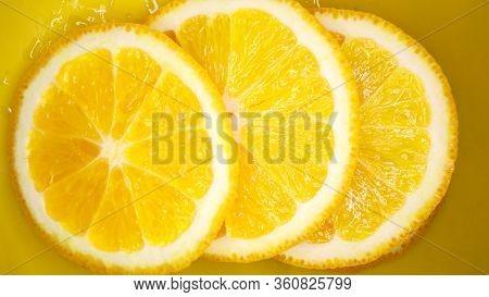Sliced Orange Backgroundjuicy Orange Slices On Yellow Background