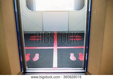Selective Focus To Floor Of Passenger Lift  With Standing Marker For Social Distancing To Avoid Spre