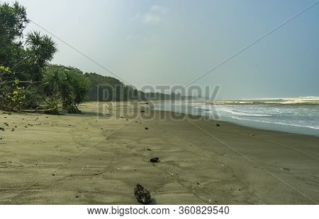 Undiscovered Wide Clean Sand Beach Scene With Big Waves In Indian Murky Ocean Seen In Bengkulu Provi