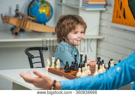 Like Chess Game. Family Holiday And Togetherness. Kid Playing Chess In The Classroom. Boy Think Or P