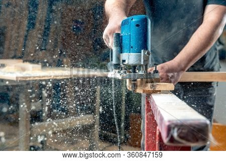 Milling Wood In The Joinery Using Manual Mechanical Cutters. Flying Sawdust In The Air. Copy Space