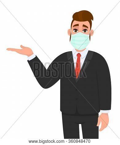 Young Business Man Wearing Medical Mask And Presenting Hand To Copy Space. Trendy Hipster Person Cov