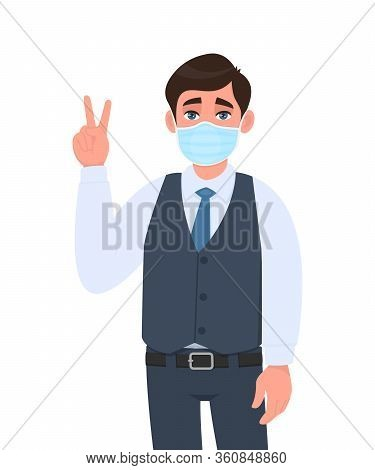 Young Businessman Wearing Medical Mask And Showing Victory, Peace Sign. Trendy Person In Waistcoat C