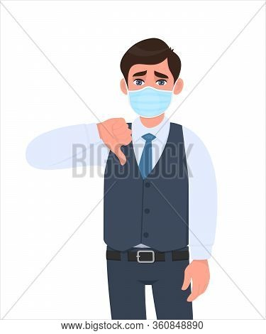Unhappy Young Businessman Wearing Medical Mask And Showing Thumbs Down Sign. Trendy Person In Waistc
