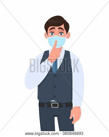 Young Business Man Wearing Medical Mask And Asking Silence. Person Keeping Finger On Lips. Male Char