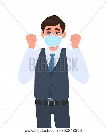 Young Businessman Wearing Medical Mask And Celebrating Raised Hand Fist. Trendy Person In Waistcoat