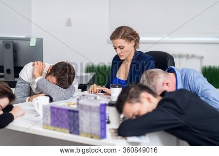 Meeting Deadlines Concept - A Team Of Exhausted Architects Working Overtime To Meet The Deadlines