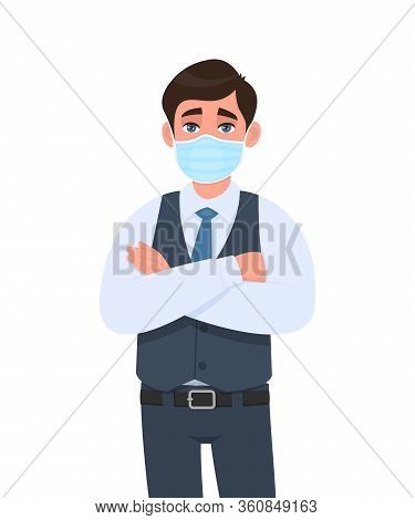 Happy Young Businessman Wearing Medical Mask And Keeping Crossed Arms. Trendy Person In Waistcoat Co