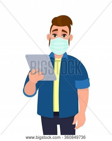 Hipster Young Man Wearing Medical Mask And Holding Tablet Computer. Trendy Person Covering Face Prot