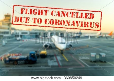 Flight Cancelled. Defocused View Of Grounded Passenger Airplanes On Empty And Closed Airfield Or Air