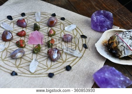 A Close Up Image Of A Crystal Energy Healing Grid Using The Flower Of Life Pattern.