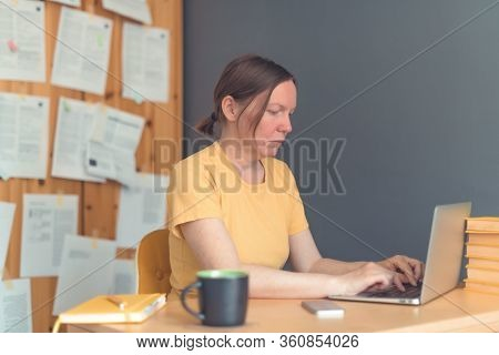 Female Freelancer Working From Home On Laptop Computer, Woman Telecommuting From Home Office, Select
