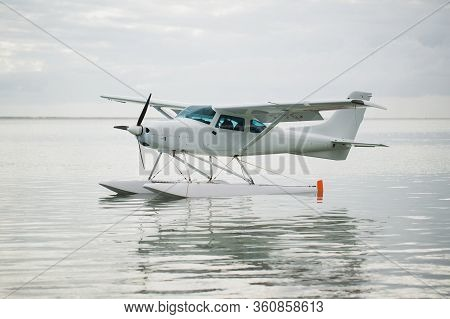 The Seaplane Is On The Surface Of The Water. Mauritius.