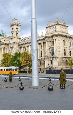 Budapest, Hungary - Nov 6, 2019: Kossuth Square With The Military Guard Of Honor. Yellow Tram And Mu
