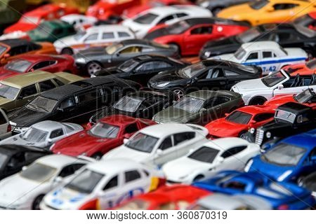 Moscow, Russia, February 2020. A Mix Of Miniature Toy Cars. Lots Of Small Toy Car Models, Mess, Top