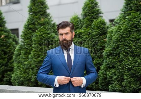 Business Man Walking Outdoor. Businessman In Nature. Energy Efficiency Concept. Bearded Man In Jacke
