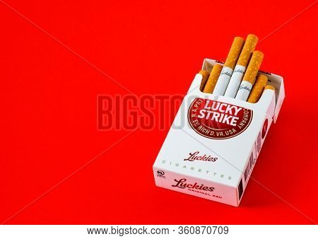 MOSCOW, RUSSIA - APRIL 04, 2020: Lucky strike cigarettes on a red background, copy space for text. Illustrative Editorial Photo