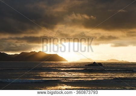 Beautiful Scenic Sunset On The Seychelles Beach.