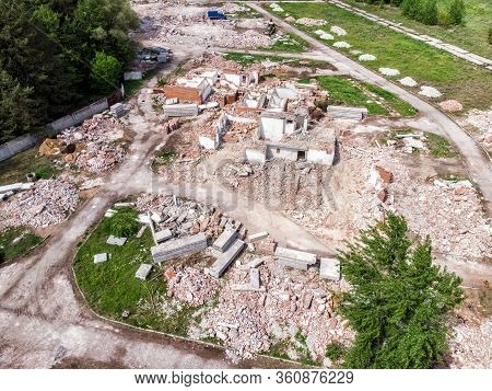 Aerial Drone View Of Old Demolished Industrial Building. Pile Of Concrete And Brick Rubbish, Debris,