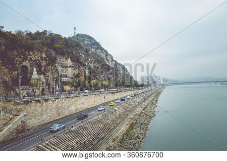 Budapest, Hungary - Nov 6, 2019: Gellert Hill Cave Church, Sziklatemplom. Liberty Statue On The Top