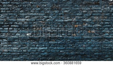 Dark blue brick wall texture, grungy background