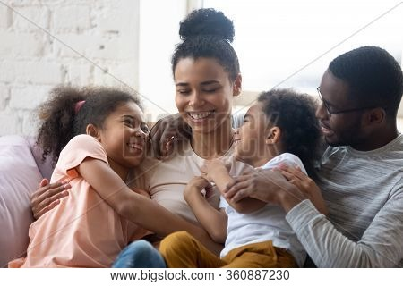 Close Up African American Happy Family With Two Children Enjoy.