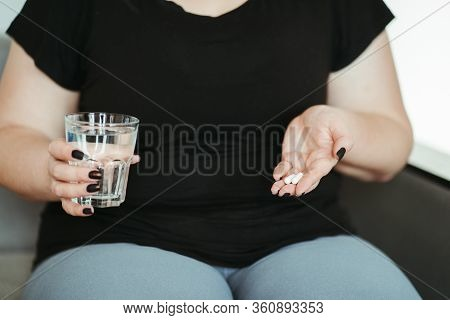 Weight Loss, Dietetic Supplements, Fat Burning Concept. Overweight Woman Take Pills. Medicine And Ph