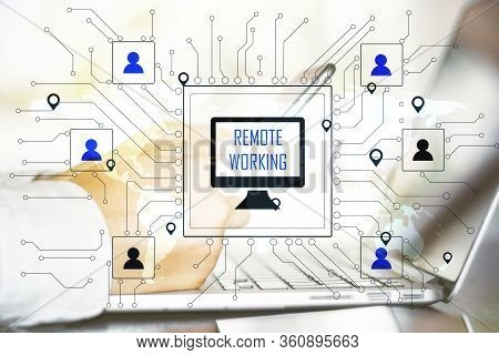Hand With Phone Using Laptop In Workplace With Remote Work Interface. Remote Access Chain Communicat