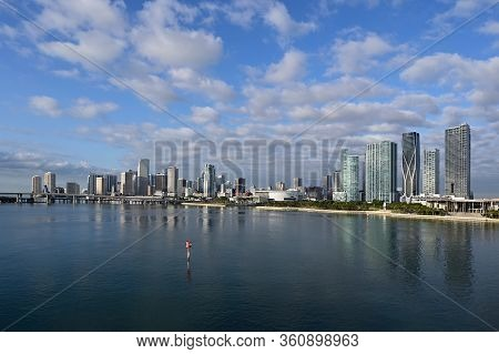 Miami, Florida - April 4, 2020 - City Of Miami Skyline Reflected In Still Blue Water Of Biscayne Bay