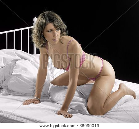 Lingerie Dressed Woman On Bed