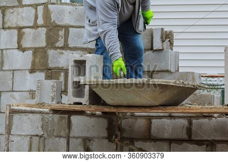 Bricklayers New House Wall On Foundation Hands With In Masonry Bricklaying