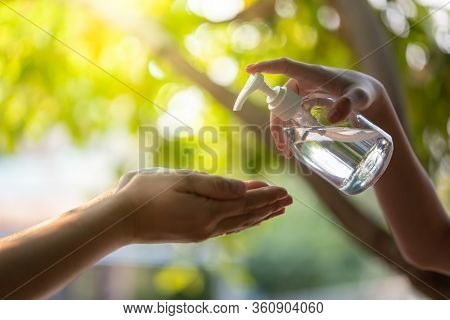 Washing Hands By Alcohol Sanitizers.