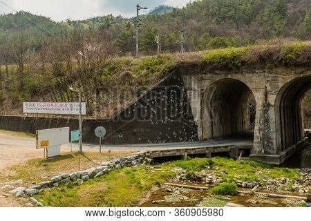 Hwanggan, South Korea; April 10, 2020: Arch Railroad Bridge With White Circles Marking Bullet Holes