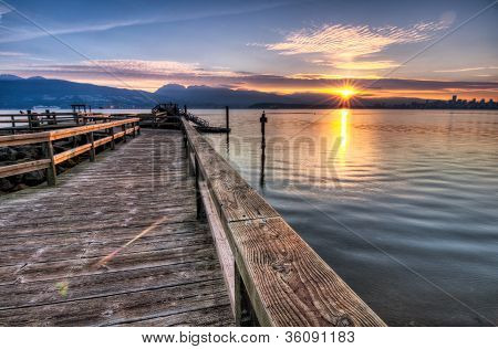Pier With Sunrise Sunstar
