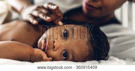 Portrait Of Enjoy Happy Love Family African American Mother Playing With Adorable Little African Ame