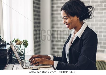 Portrait Of Smiling Happy African American Black Woman Relaxing Using Technology Of Laptop Computer