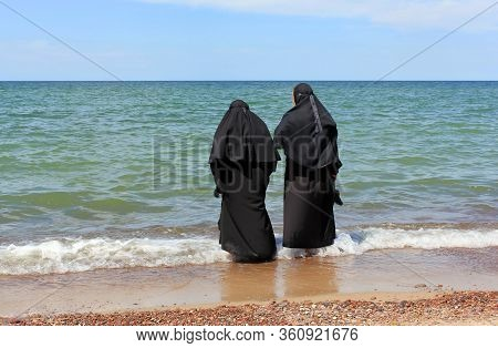 Nuns On The Baltic Sea. Curonian Spit.  The Curonian Spit Is A Narrow And Long Sandy Spit That Separ