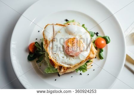 Grilled Toast Sandwich With Cheese And Sunny Side Up Fried Egg.two Croque-monsieur Sandwiches.double